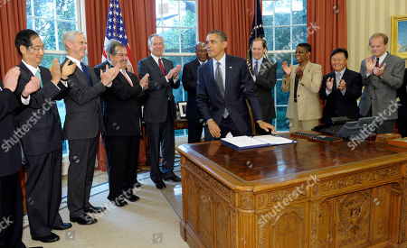Barack Obama, Han Duk Soo, John Bryson, Andrew Liveris, Jim McNerney, Ron Kirk, Dave Camp, Ursula Burns, William Hwang, William Yeargin President Barack Obama stands after signing the Korean Free Trade Agreement in the Oval Office of the White House in Washington, . He is joined by, from left, Korean Ambassador Han Duk-soo, Commerce Secretary John Bryson, DOW Chemical Company CEO Andrew Liveris, Boeing CEO Jim McNerney, US Trade Representative Ron Kirk, Rep. Dave Camp, R-Mich., Xerox CEO Ursula Burns, Korean Alliance for Free Trade William Hwang and Correct Craft, Inc., CEO William Yeargin