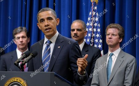 Barack Obama, Eric Holder, Shaun Donovan, Roy Cooper President Barack Obama speaks about a mortgage settlement, in the Eisenhower Executive Office building on the White House complex in Washington. From left are, North Carolina Attorney General Roy Cooper, the president, Attorney General Eric Holder, and Housing and Urban Development Secretary Shaun Donovan