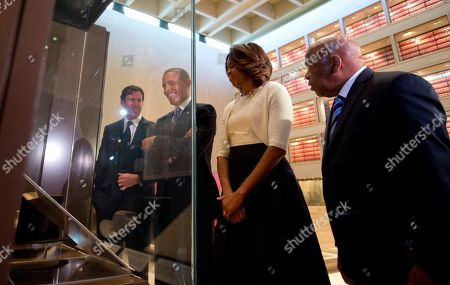 Barack Obama, Michelle Obama, Mark Updegrove, John Lewis From left, Mark Updegrove Director of the LBJ Presidential Library, President Barack Obama and first lady Michelle Obama and Rep. John Lewis, D-Ga., tour and exhibit in the Great Hall at the LBJ Presidential Library, in Austin, Texas, as they attend a Civil Rights Summit to commemorate the 50th anniversary of the signing of the Civil Rights Act