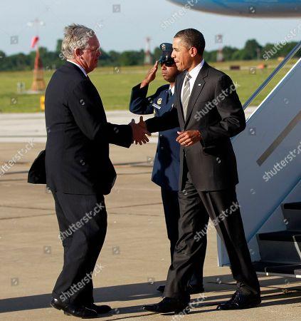 Barack Obama, Jay Nixon President Barack Obama, right, is greeted by Missouri Gov. Jay Nixon, left, during his arrival at Joplin Regional Airport, in Joplin, Mo