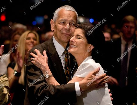 """Julian Bond, Luci Baines Johnson Social activist Julian Bond hugs Luci Baines Johnson, the younger daughter of President Lyndon Baines Johnson after singing """"We Shall Overcome"""" during the Civil Rights Summit to commemorate the 50th anniversary of the signing of the Civil Rights Act in Austin, Texas. Bond, a civil rights activist and longtime board chairman of the NAACP, died, according to the Southern Poverty Law Center. He was 75"""