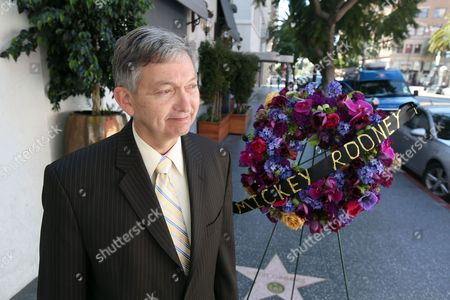"""Mickey Rooney Leron Gubler Hollywood Chamber President Leron Gubler speaks to the media after flowers are placed on the Hollywood Walk of Fame star of Hollywood legend, Mickey Rooney, on Vine Street, in the Hollywood section of Los Angeles. The iconic actor, Rooney, died at 93 on Sunday, April 6, 2014. Over a four-decade span, he was nominated for four Academy Awards,and received two special Oscars for film achievements, won an Emmy for his TV movie """"Bill"""" and had a Tony nomination for his Broadway smash """"Sugar Babies"""