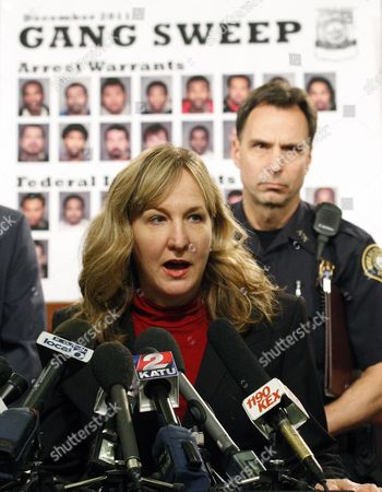 Amanda Marshall Amanda Marshall, the United States Attorney for the District of Oregon, speaks with reporters during a gang sweep news conference, as Portland Police Chief Mike Reese looks, in Portland, Ore. Marshall was appointed by President Obama and took office Oct. 7