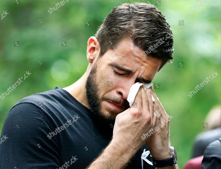 "Josh Segarra Josh Segarra, of Orlando, Fla., sheds tears following a tribute a tribute to the Orlando nightclub shooting victims at the ""Survivor Tree"" of the 9/11 Memorial and Museum, in New York. The tree was removed from the World Trade Center rubble after the 9/11 attacks and placed cared for by the New York City Department of Parks and Recreation. After its recovery and rehabilitation, in 2010, the tree was returned to the Memorial"