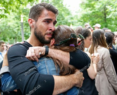 "Josh Segarra Josh Segarra, who is from Orlando, Fla., embraces his wife Brace following a tribute a tribute to the Orlando nightclub shooting victims at the ""Survivor Tree"" of the 9/11 Memorial and Museum, in New York. The tree was removed from the World Trade Center rubble after the 9/11 attacks and placed cared for by the New York City Department of Parks and Recreation. After its recovery and rehabilitation, in 2010, the tree was returned to the Memorial"