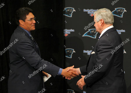 Ron Rivera, Jerry Richardson Carolina Panthers owner Jerry Richardson, right, shakes hands with new head coach Ron Rivera during a news conference in Charlotte, N.C