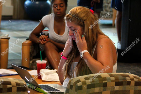 Jessica Knoll, Ayanna Jones Penn State freshman Jessica Knoll, from Lebanon, Pa., right, wipes tears from her eyes as she reads the Freeh Report on her computer while she and freshman Ayanna Jones, rear left, of Queens, New York, listen to the press conference held by former FBI director Louis Freeh on a television in the student HUB on Penn State University's main campus in State College, Pa