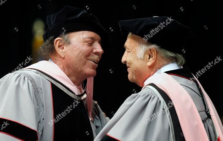 Stock Picture of Julio Iglesias, Doug Morris Julio Iglesias, left, speaks with CEO of Sony Music Entertainment Doug Morris, right, during Berklee College of Music commencement ceremonies, in Boston. Iglesias and Morris each received an honorary doctor of music degree from the college