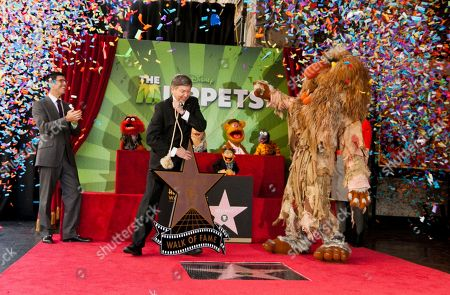 Rich Ross, Leron Gubler, Sweetums Walt Disney Studios Chairman, Rich Ross, far left, with Leron Gubler, Hollywood Chamber of Commerce President and CEO, center, and Jim Henson's character Sweetums, right, pose with The Muppets as they are honored with a Star on the Hollywood Walk of Fame in Los Angeles on