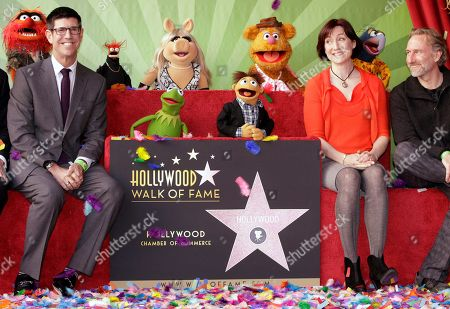 Lisa Henson, Rich Ross, Brian Henson Walt Disney Studios Chairman, Rich Ross, left, poses with Lisa Henson, Chief Executive Officer, and Brian Henson, Chairman of The Jim Henson Co., right, and The Muppets, as they are honored with a Star on the Hollywood Walk of Fame in Los Angeles on