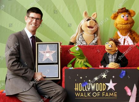 Rich Ross Walt Disney Studios Chairman, Rich Ross poses with Muppets characters, from left, Kermit the Frog, Miss Piggy, Walter and Fozzie Bear as they are honored with a star on the Hollywood Walk of Fame in Los Angeles on