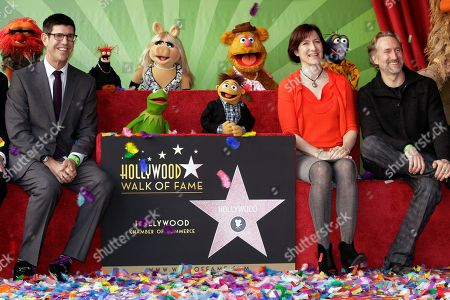 Rich Ross, Lisa Henson, Brian Henson Walt Disney Studios Chairman, Rich Ross, left, and the children of the late Muppets creator Jim Henson, Lisa Henson, CEO, and Brian Henson, Chairman of The Jim Henson Co., pose with The Muppets characters, from left, Animal, Pepe the King Prawn, Kermit the Frog, Miss Piggy, Walter, Fozzie Bear and Gonzo as they are honored with a star on the Hollywood Walk of Fame in Los Angeles on