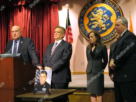 James Carver, Arthur Lopez, Edward Mangano, Kathleen Rice, George Maragos Nassau County PBA President James Carver, left, discusses the shooting death of Police Officer Arthur Lopez, shown in picture on table, at a news conference, at Police Headquarters in Mineola, N.Y. Listening from second left are Nassau County Executive Edward Mangano, District Attorney Kathleen Rice, County Comptroller George Maragos and First Deputy Police Commissioner Thomas Krumpter. A motorist fleeing a possible hit-and-run traffic accident fatally shot Lopez in broad daylight Tuesday near the Belmont racetrack and then apparently killed another driver not far away during a carjacking, authorities said