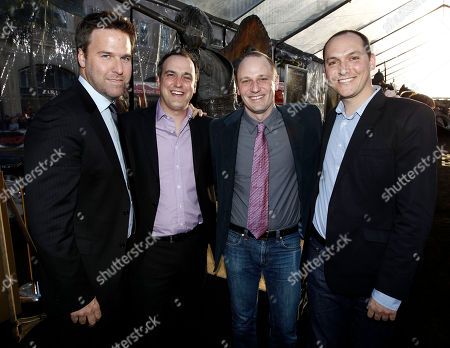 """Basil Iwanyk, Matt Manfredi, Phil Hay, Louis Leterrier From left, producer Basil Iwanyk, writer Matt Manfredi, writer Phil Hay, and director Louis Leterrier pose together at the premiere of """"Clash of the Titans"""" in Los Angeles on"""