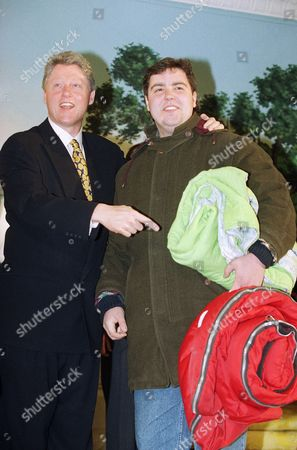 Bill Clinton, Andrew Levy President Clinton gestures toward Andrew Levy, 20, of Livingston, New Jersey during the president's open house at the White House in Washington on . Levy, carrying his sleeping bag, slept on the Mall in Washington overnight to try and get into the White House to meet the president during the inauguration week open house