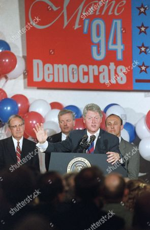 Bill Clinton, George Mitchell, Joe Brenna, Tom Andrews President Bill Clinton addresses a crowd at one of two state Democratic fund raising events in Portland, Maine . In the background, Left to Right are Senate Majority Leader George Mitchell, Democratic gubernatorial candidate Joe Brennan, and U.S. Rep. Tom Andrews who is running for the Senate