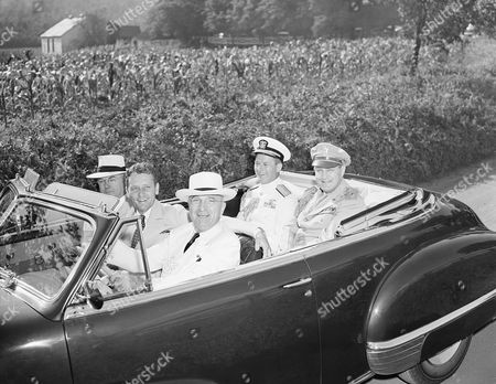 Harry Truman, John Snyder, Stanley Woodward, James Foskett President Truman smiles broadly as he takes the wheel of his new convertible club coupe as he starts on drive in the Charlottesville, Va., area on during his holiday weekend vacation. With him are (l to r) Secretary of Treasury John W. Snyder; Stanley Woodward, State Department protocol chief and his host; rear Adm. James H. Foskett, Naval Aide, and Maj. Gen. Harry H. Vaughn, Military Aide