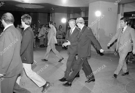 Stock Picture of Jimmy Carter President Jimmy Carter leaves the State Department in Washington on after a briefing on the possible settlement for the release of the Americans held hostage in Iran. At right is Under Secretary of State David Newsom