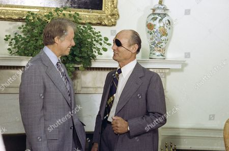 Jimmy Carter, Moshe Dayan President Jimmy Carter with Israeli's Foreign Minister Moshe Dayan in the Oval Office of the White House in Washington in September 1977