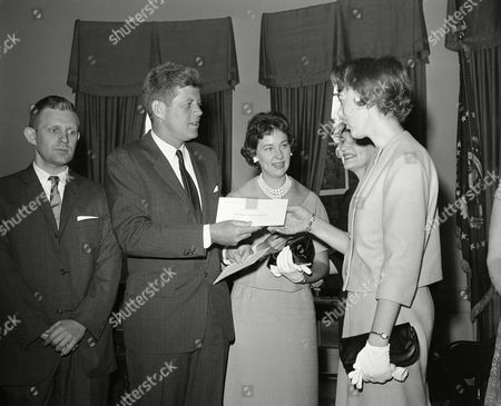 Stock Picture of John Kennedy, Daniel Webber, Cheryl Lynn Martin President John Kennedy poses with blind students to whom he presented $500 awards for scholastic achievement in a ceremony at the White House in Washington on . From left are Daniel R. Webber of Saginaw, Mich., and the Notre Dame Law School; Kennedy; Cheryl Lynn Martin of Mansfield, Ohio, and Witteberg University; Cheryl?s mother, Mrs. James Martin, and Helen Vivian Aareskjold of Brooklyn, Ny., and Clark University