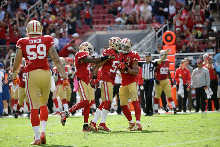 Michael Wilhoite, Eric Reid, Antoine Bethea San Francisco 49ers linebacker Michael Wilhoite, center, celebrates with strong safety Antoine Bethea, left, and safety Eric Reid after intercepting Baltimore Ravens quarterback Joe Flacco during the first half of an NFL football game in Santa Clara, Calif