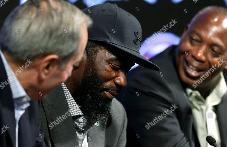 Ed Reed, Ozzie Newsome, Dick Cass Baltimore Ravens safety Ed Reed, center, smiles at an NFL football news conference while announcing his retirement alongside team president Dick Cass, left, and general manager and executive vice president Ozzie Newsome, in Owings Mills, Md