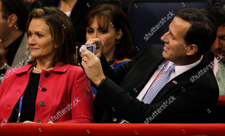 Pennsylvania Senator Rick Santorum takes a picture of his wife Karen during the Republican National Convention in Tampa, Fla., on
