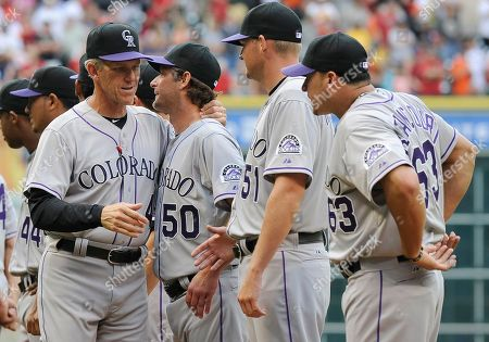 Jim Tracy, Jamie Moyer, Matt Reynolds, Rafael Betancourt Colorado Rockies manager Jim Tracy, left, greets pitcher Jamie Moyer (50), Matt Reynolds (51) and Rafael Betancourt (63) during opening day ceremonies before the baseball game against the Houston Astros, in Houston