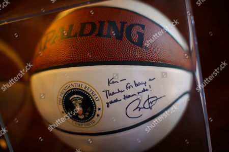 A basketball signed by President Barack Obama for Interior Secretary Ken Salazar is seen in his office at the Department of Interior in Washington