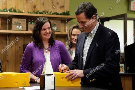 Rick Santorum, Mary McCauley, Karen Santorum Store manager Mary McCauley, left, watches as Republican presidential candidate, former Pennsylvania Sen. Rick Santorum autographs a cheese head hat at Simon's Specialty Cheese in Appleton, Wis., . Santorum's wife Karen is at center