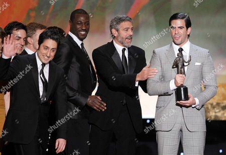 "Omar Doom, left, Jacky Ido, second from left, and Eli Roth, right, accept the award for best cast of a movie for ""Inglourious Basterds"" from George Clooney, second from left, at the 16th Annual Screen Actors Guild Awards, in Los Angeles"