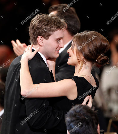 """Stock Photo of Aaron Stanton, Connie Fletcher Aaron Stanton from the cast of """"Mad Men"""" kisses his wife, Connie Fletcher after his show won the award for ensemble in a drama series at the 16th Annual Screen Actors Guild Awards, in Los Angeles"""