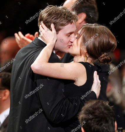 """Stock Picture of Aaron Stanton, Connie Fletcher Aaron Stanton from the cast of """"Mad Men"""" kisses his wife, Connie Fletcher after his show won the award for ensemble in a drama series at the 16th Annual Screen Actors Guild Awards, in Los Angeles"""