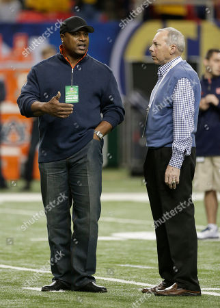 Bo Jackson, Pat Sullivan Former Auburn players and Heisman Trophy winners' Bo Jackson, left and Pat Sullivan speak on the field before the first half of the Southeastern Conference NCAA football championship game between the Auburn and the Missouri, in Atlanta
