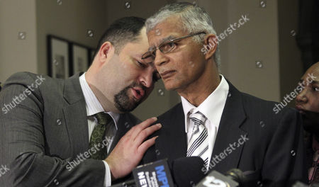 Chokwe Lumumba, Benjamin Jealous Attorney Chokwe Lumumba, right and NAACP National President Benjamin Jealous confer during a news conference about the pending release of sisters Gladys and Jamie Scott at the Capitol in Jackson, Miss., . Mississippi Gov. Haley Barbour suspended the life sentences of the two women Wednesday, Dec. 29. The two women were convicted in 1994 for their roles in an armed robbery that netted $11. Barbour said in a news release that 36-year-old Gladys Scott's release is conditioned on her donating one of her kidneys to her sister, who now requires daily dialysis