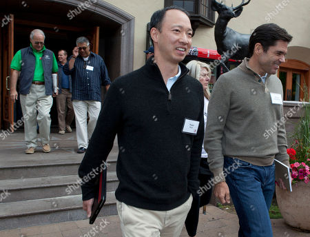 Roger Kuo, Alfonso de Angoitia Roger Kuo walks with Alfonso de Angoitia, executive vice president of Grupo Televisa, at the Sun Valley Inn for the 2011 Allen and Co. Sun Valley Conference, in Sun Valley, Idaho