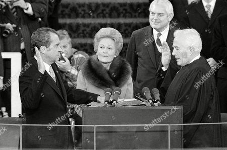 Richard Nixon, Patricia Nixon, Warren Burger U.S. President Richard Nixon takes the oath of office in Washington, D.C., from Chief Justice Warren E. Burger for the president's second term. Mrs. Nixon holds two family Bibles