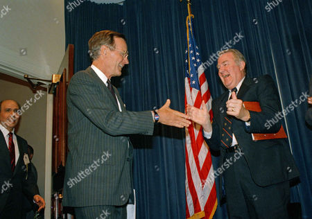 George Bush U.S. Vice President George Bush reaches out to shake the hand of Attorney General Edwin Meese III as the vice president arrives to address the Cuban-American Foundation in Washington