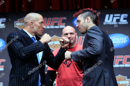 Georges St. Pierre, Dan Hardy, Dana White UFC president Dana White, center, watches as Dan Hardy, right, and Georges St. Pierre, pose for photographers during a news conference at Radio City Music Hall, in New York