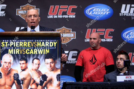 Georges St. Pierre, Dan Hardy, Dana White UFC president Dana White, center, and Dan Hardy, right, watch as Georges St. Pierre speaks to reporters during a news conference at Radio City Music Hall, in New York
