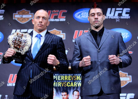 Georges St. Pierre, Dan Hardy Georges St. Pierre, left, and Dan Hardy pose for photographers during a news conference at Radio City Music Hall, in New York. The two are scheduled to meet Saturday in Newark, N.J., in UFC 111 for St. Pierre's mixed martial arts title