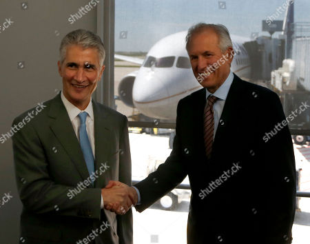 Jim McNerney, Jeff Smisek Jeff Smisek, Chairman, President and CEO, United Airlines, left, and Jim McNerney, Chairman and CEO, The Boeing Company, pose for photographers after the pair arrived on United Airlines Flight # 1, a Boeing 787 Dreamliner aircraft from, Houston, Texas, at Chicago's O'Hare International Airport . The planes are returning after being grounded for four months by the federal government because of smoldering batteries on 787s owned by other airlines