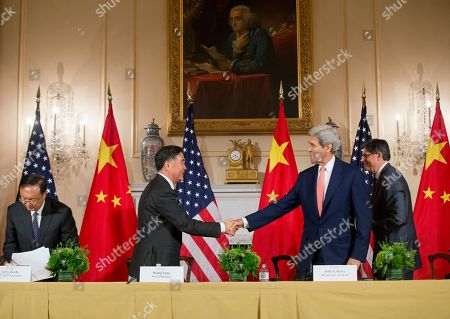 Wang Yang, Yang Jiechi, John Kerry, Jack Lew Secretary of State John Kerry, right, shakes hands with China's Vice Premier Wang Yang, left, as China's State Councilor Yang Jiechi, far left, and Secretary of Treasury Jack Lew, far right, get up from their seats at the conclusion of the US China Closing Statements at US China Strategic and Economic Dialogue (S&ED) at the US State Department in Washington