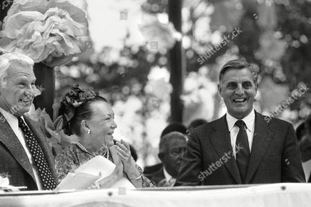 Vice President Walter Mondale is greeted, by actor Eddie Albert and his wife, Margo, as Los Angeles began two years of celebrations honoring the city's birthday. Albert and his wife were co-hosts at a downtown party at which Mondale spoke as the city began a round of parties on Olvera Street, Los Angeles traditional founding place