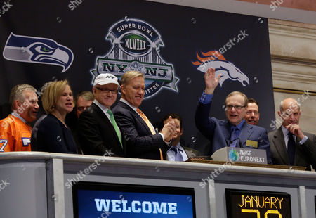Paul Allen, Laurie Tisch, Woody Johnson, John Elway, Jon Tisch Seattle Seahawks owner Paul Allen, second from right, waves to the trading floor after ringing the New York Stock Exchange's opening bell, . He is joined by, front row, from left: New York Giants co-owner Laurie Tisch, New York Jets owner Woody Johnson; Denver Broncos executive vice president of football operations John Elway; and Giants co-owner Jon Tisch. The Seahawks face the Broncos in Super Bowl XLVIII on Suday in East Rutherford, N.J