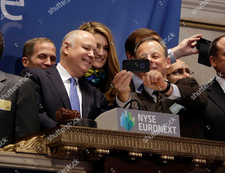 Jeffrey Sprecher, Kelly Loeffler, David Goone Intercontinentalexchange Chairman and CEO Jeffrey Sprecher, left, and ICE Vice President of Corporate Affairs Kelly Loeffler, second left, look at mobile phone photos of company Chief Strategy Officer David Goone on the bell podium of the New York Stock Exchange . The Dow Jones industrial average crossed 16,000 points for the first time early Monday and the Standard & Poor's 500 index crossed 1,800 points
