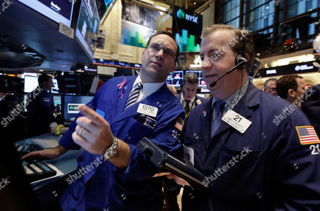 Anthony Matesic, James Doherty Specialist Anthony Matesic, left, and trader James Doherty on the floor of the New York Stock Exchange . The stock market is opening little changed following last week's strong U.S. jobs report