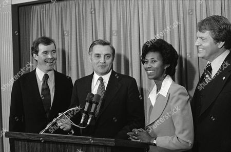 Stock Picture of U.S. Vice President Walter Mondale laughs with Calif., congressional candidate Carey Peck, left, son of actor Gregory Peck, and Calif., attorney-general candidate Yvonne Brathwaite-Burke during a Democratic reception for Carey Peck in Los Angeles, Calif., . Man at right is unidentified