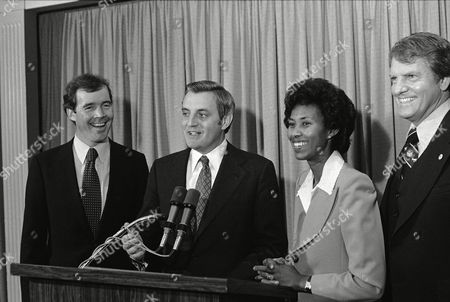 Stock Photo of U.S. Vice President Walter Mondale laughs with Calif., congressional candidate Carey Peck, left, son of actor Gregory Peck, and Calif., attorney-general candidate Yvonne Brathwaite-Burke during a Democratic reception for Carey Peck in Los Angeles, Calif., . Man at right is unidentified