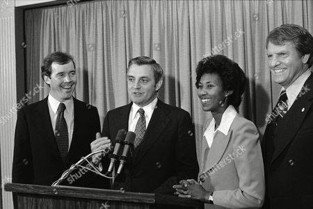 Stock Image of U.S. Vice President Walter Mondale laughs with Calif., congressional candidate Carey Peck, left, son of actor Gregory Peck, and Calif., attorney-general candidate Yvonne Brathwaite-Burke during a Democratic reception for Carey Peck in Los Angeles, Calif., . Man at right is unidentified